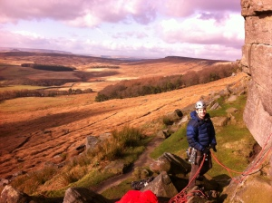 Jonny belaying on a spring day at Stanage