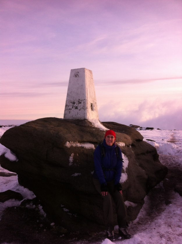 Anna at the trig point on Kinder, taking the Pennine Way back down to Jacob's Ladder