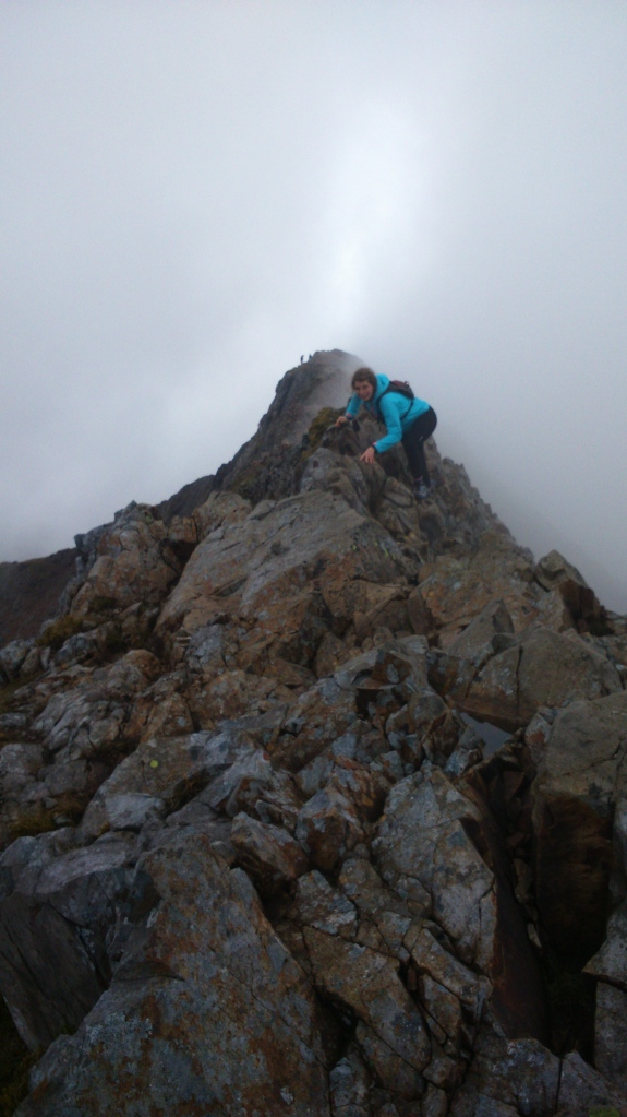 Bo captured mid-scramble, the knife edge ridge disappearing into cloud