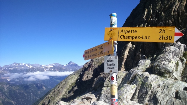 Signs marking the high point of the TMB at 2665m
