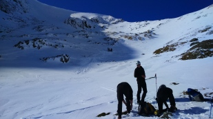 Mark overseeing crampon application, we'll be heading up to the ridge in the background.