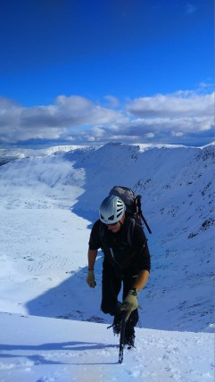 Mark arriving at Swirral Edge, Red Tarn below and Striding Edge behind.